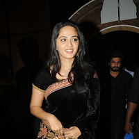 Enticing Anushka Shetty in black saree at varna audio launch
