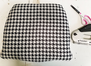 black and white houndstooth covered chair