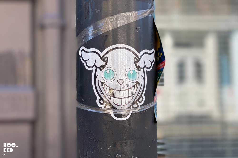 London Street Art - Shoreditch Sticker Art featuring artist Dface