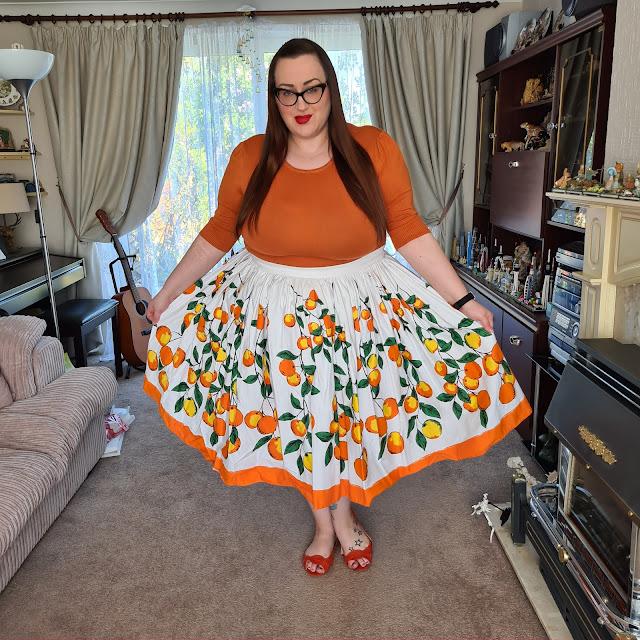 Pin Up Girl Clothing Orange print skirt