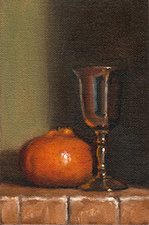 Oil painting of a mandarine beside a small silver-plated goblet.