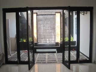 Contoh Motif Desain Model gambar kusen pintu aluminium kaca rumah minimalis paling terbaru dan bagus.