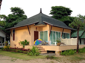 """Bungalow style home designs were very popular anywhere in the world. Their layouts were very cheap, low-cost and affordable, and offered simple living with an artistic touch. Bungalow houses include one and a half stories with most living spaces on the ground, a low-pitched roof, and efficient floor plans and layouts. Bungalow home layouts position the living room in the center of the house floor plan, making them truly family friendly. It is usually for bungalows to have a secured entryway patio or sunroom with numerous windows making it a bright style for its littler size.  Bungalow homes will be homes that comprise of all the fundamental living regions situated on one story. The elimination of a second floor brings about the end of stairs, which can be alluring to certain property holders. These house designs can be intended to meet any size, style, or time that is wanted. Ordinarily, bungalow homes are the costliest homes to work as the state of the house is generally lengthened and hence, requires more concrete and rooftop.  The term """"Bungalow"""" may refer to any humbly measured, one or one-and-a-half story home. Their basic designs and general moderateness influenced Bungalows to idealize contender for design books and kit homes, spreading their popularity all throughout the country. The Bungalow house configuration may highlight open idea format, with kitchen, rooms, and washrooms orchestrated simple availability. In spite of the fact that most bungalows have all the earmarks of being just a single story from the road, many offer a half-story under the rooftop, with upstairs rooms lit by shed-roofed dormers.  Check some out of these 50 photos of bungalow house designs for your inspiration."""