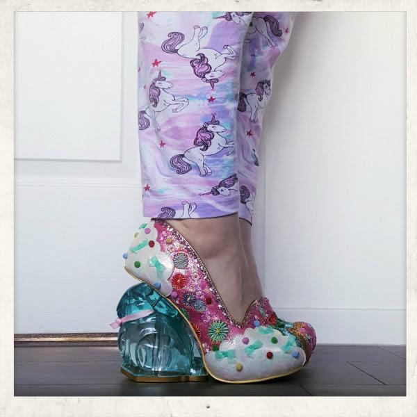 wearing irregular choice pink rainbunny shoes
