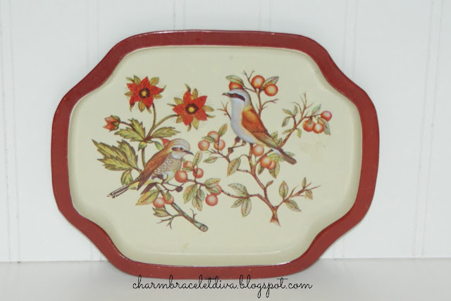 tin tray with red birds berries and flowers