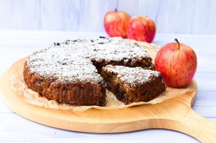 Sliced Red Apple & Treacle Fruit Cake on a Wooden Board