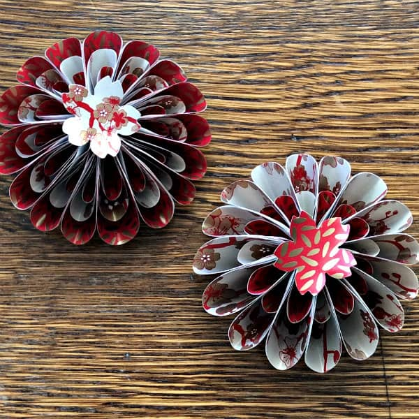 two flower-like tree ornaments made from Asian patterned papers