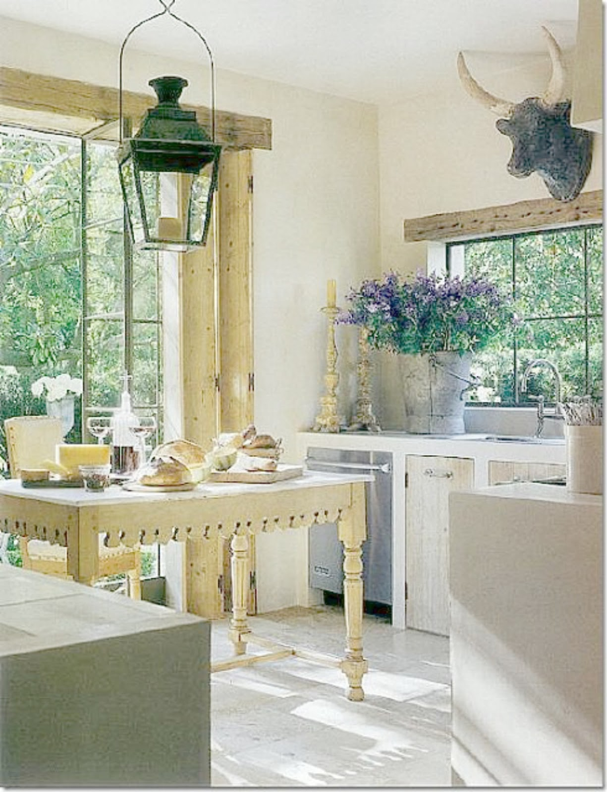 French Country kitchen decor with antiques and reclaimed materials from Europe! Pamela Pierce's gorgeous home with sophisticated French Country decor and European farmhouse charm on Hello Lovely Studio