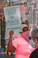 "Person holding a sign: ""Protect the Preborn"""