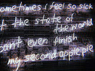 neon sign saying 'sometimes i feel so sick at the state of the world I can't finish my second apple pie'