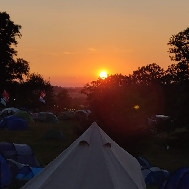 sunset at campsite at Cornbury Festival, Great Tew park