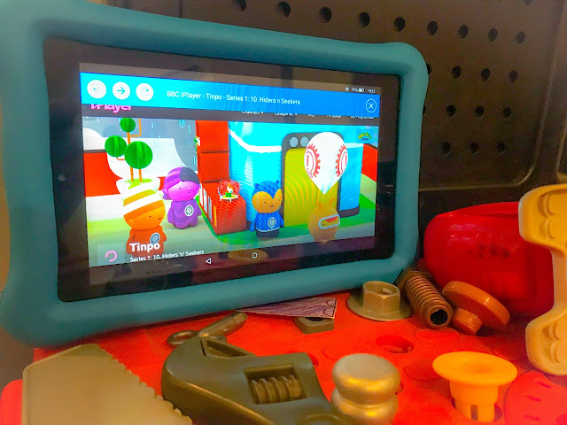 Tablet showing Tinpo TV show whilst resting on a kids workbench