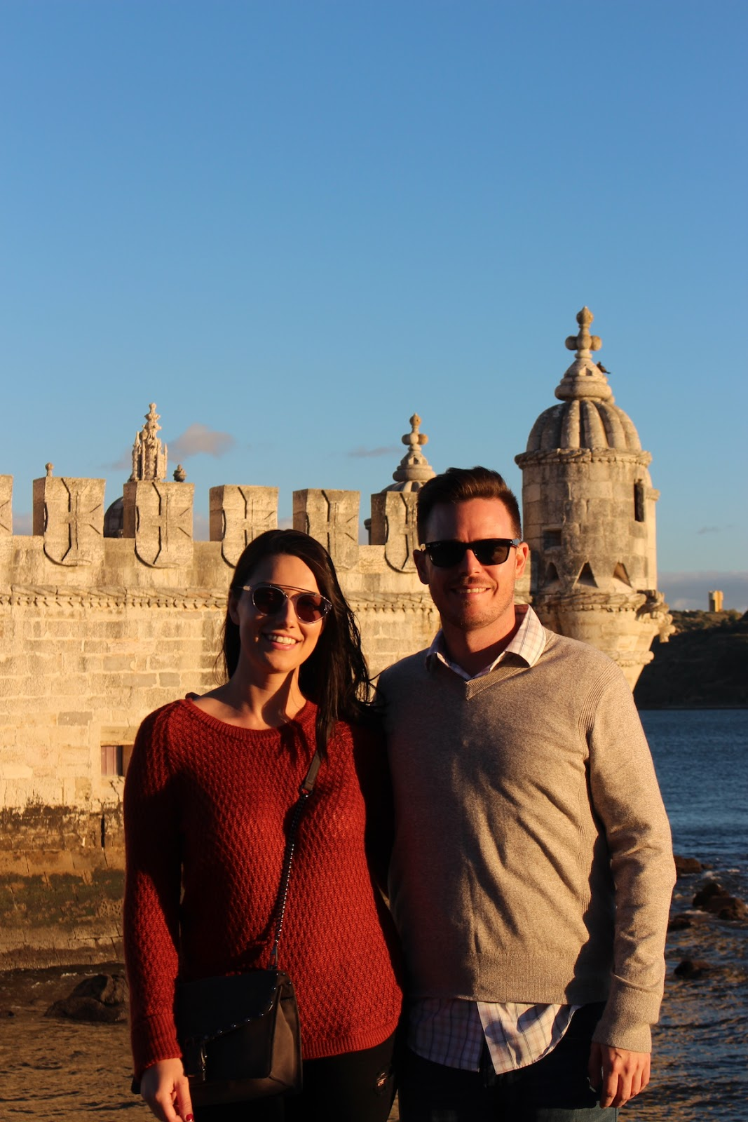 This is a photo of my boyfriend and I, in front of the Belem Tower, in Lisbon Portugal.