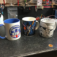 3 mugs in a row