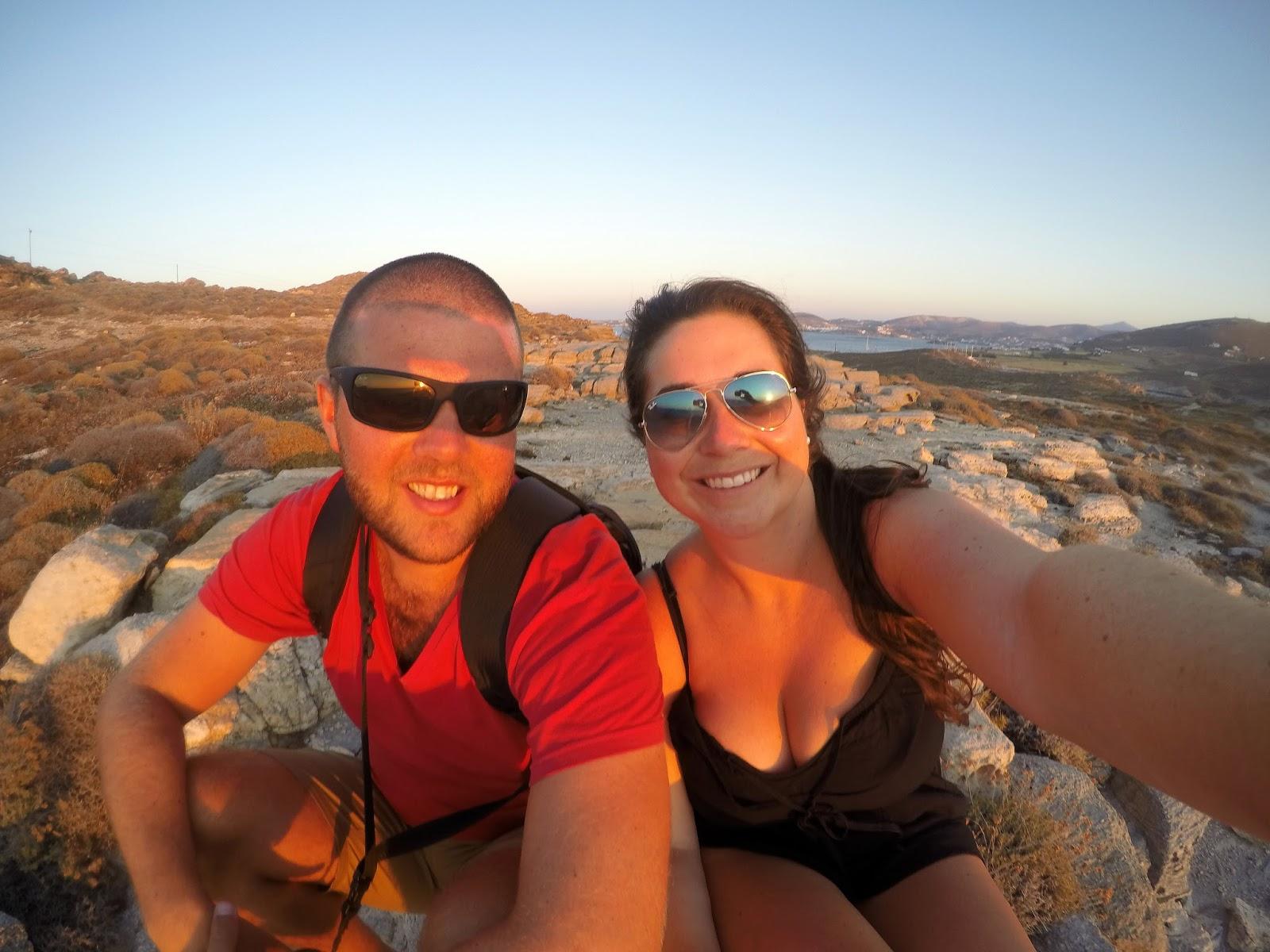 Couple watching Sunset over Paros Greek Islands