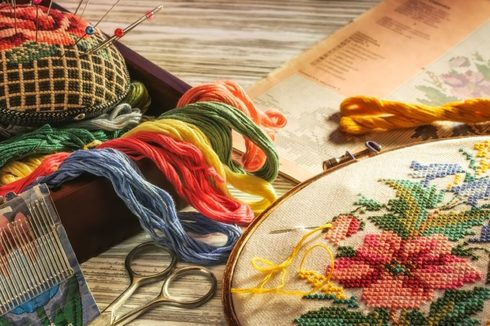Colorful sewing threads and flower patterns