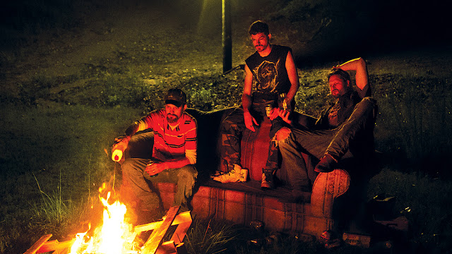 a nickel back cover band sits by a bonfire in alabama