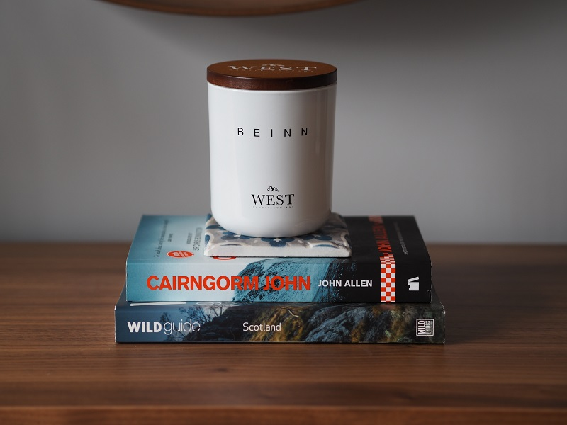 West Candle Co Beinn candle, with Cairngorm John and Wild Guide Scotland books