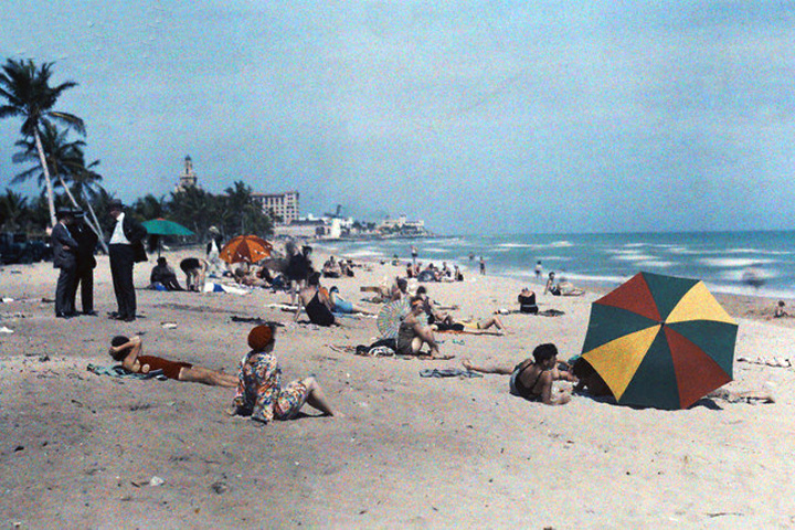 1930 Miami Beach Florida Usa A Group Of People On Sunbathe And Look Out The Ocean Image By Clifton R Adams National Geographic