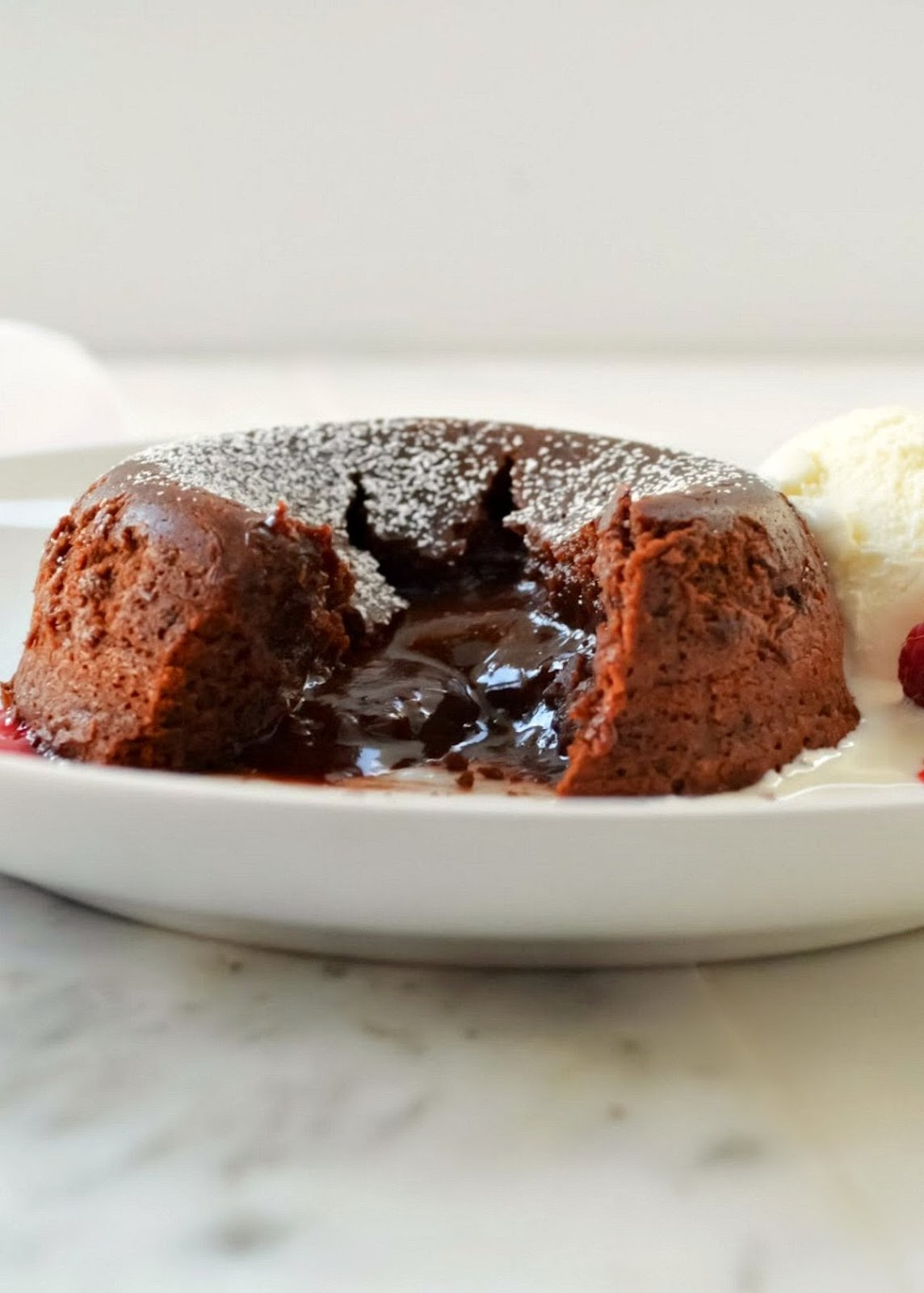 Warm molten chocolate coming out of the center of a Lava Cake is what makes these a favorite dessert recipe from Serena Bakes Simply From Scratch.