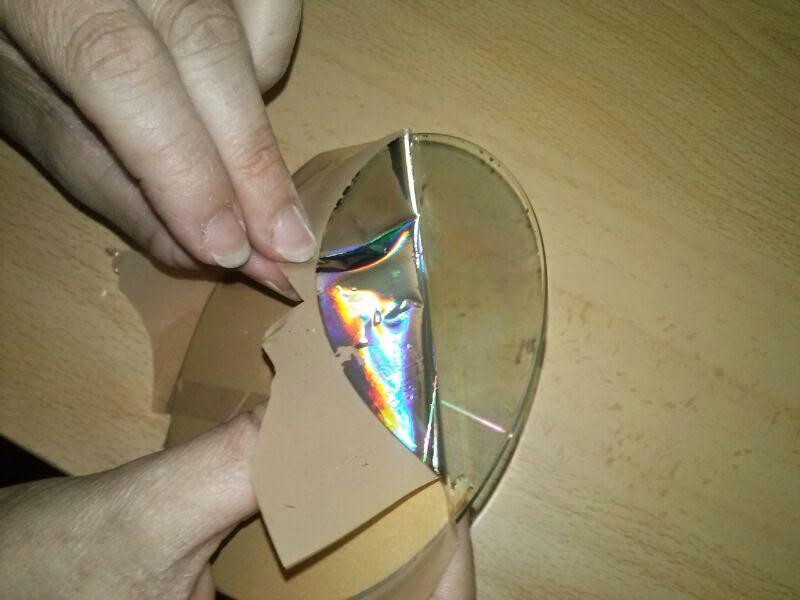 CD con cinta para quitar capa plateada