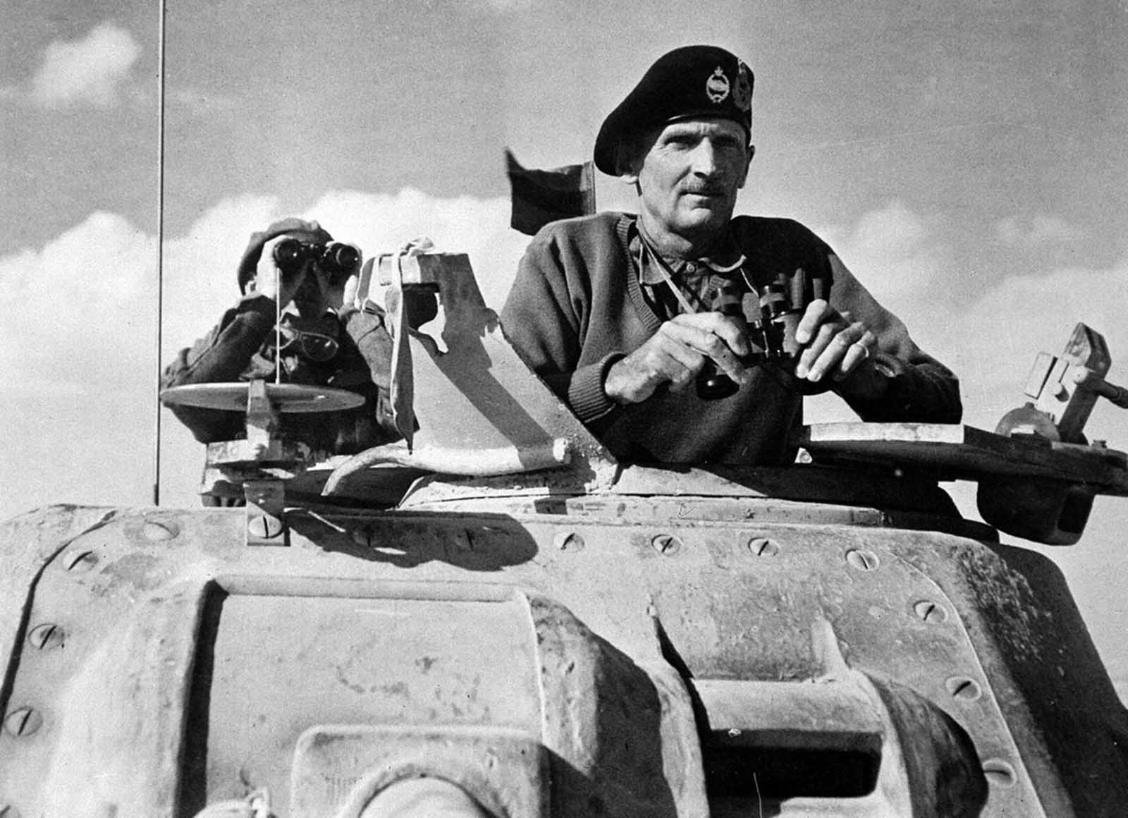 Britain's General Bernard Montgomery, Commander of the Eighth Army, watches battle in Egypt's Western Desert, from the turret of an M3 Grant tank, in 1942.