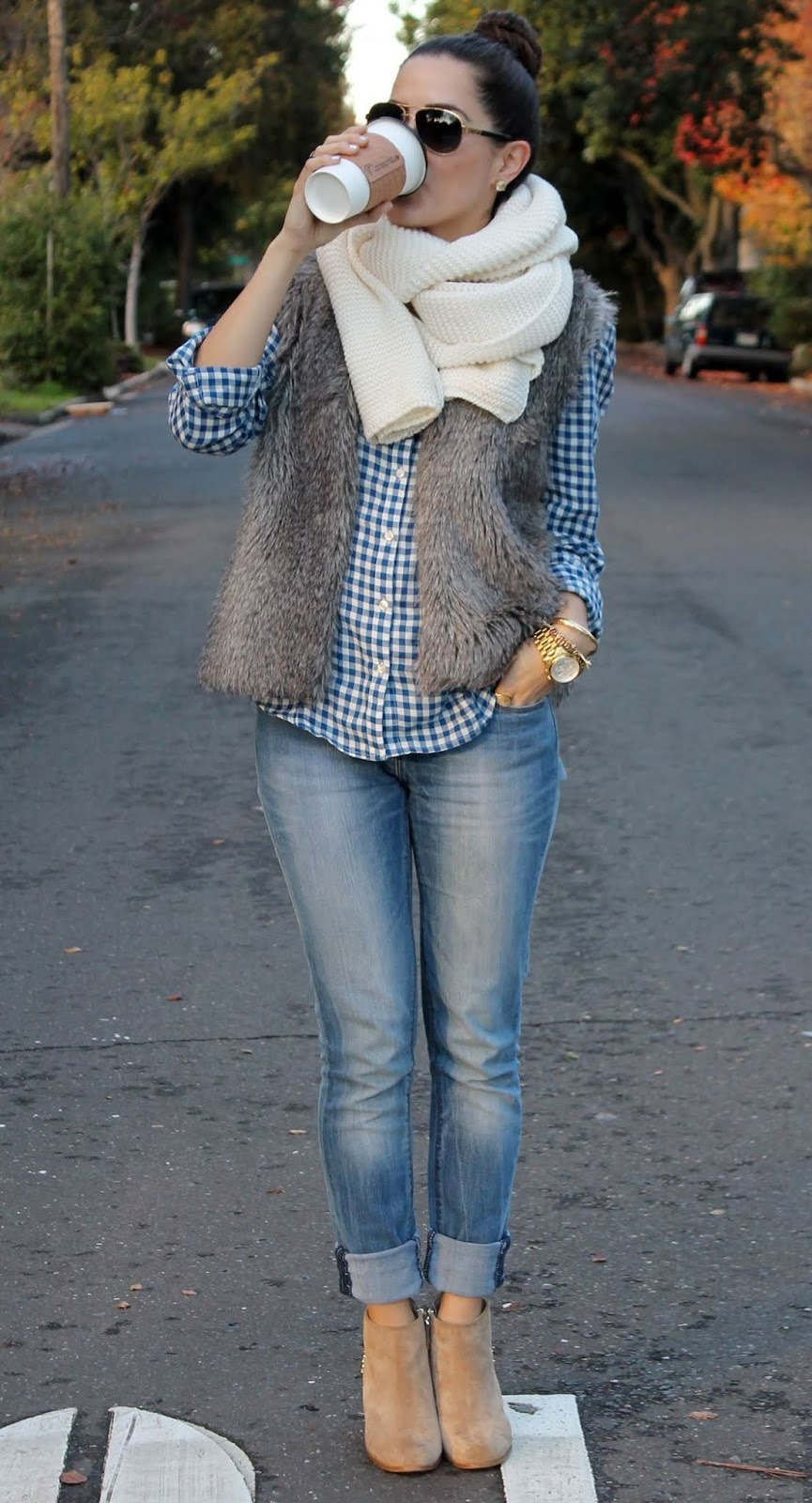 how to style a fur vest : white scarf + plaid shirt + skinny jeans + boots