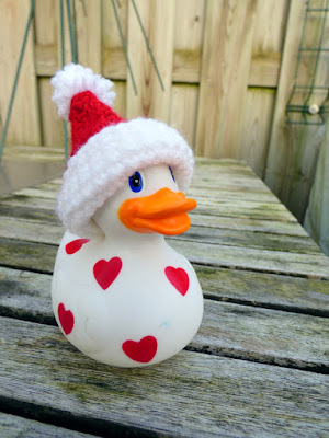 Plastic Duck with hearts in crocheted santa hat