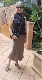 A silk khaki skirt worn with strappy sandals by over-50s blogger Anna Marcus, as shown on Is This Mutton #WowOnWednesday