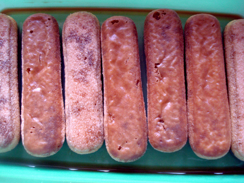 lady fingers dipped in the coffee and liqueur mixture