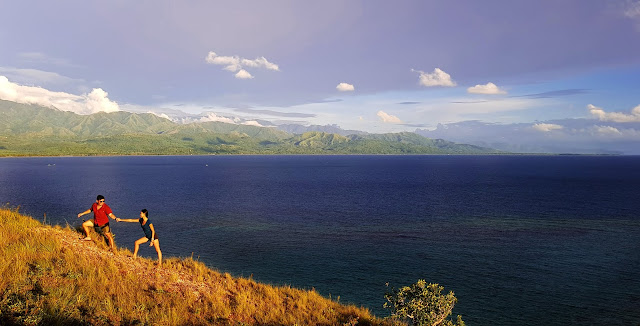 At the ridge-side of Lantawan Peak in Mararison Island with mainland Antique in the background || GREGG YAN