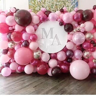 Personalized backdrop by organic balloon wall