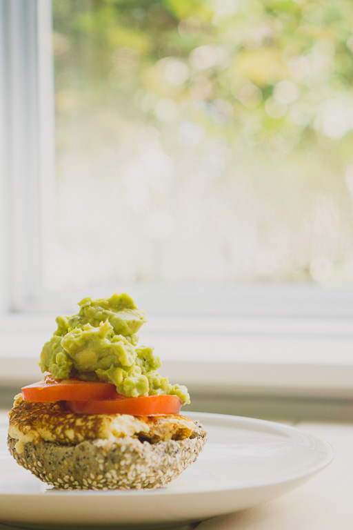 A Low-GI cape seed loaf served with an omelette (cooked in coconut oil), slices of fresh tomatoes and smashed avocado with low fat ricotta. Super simple but very delicious! | in happenstance