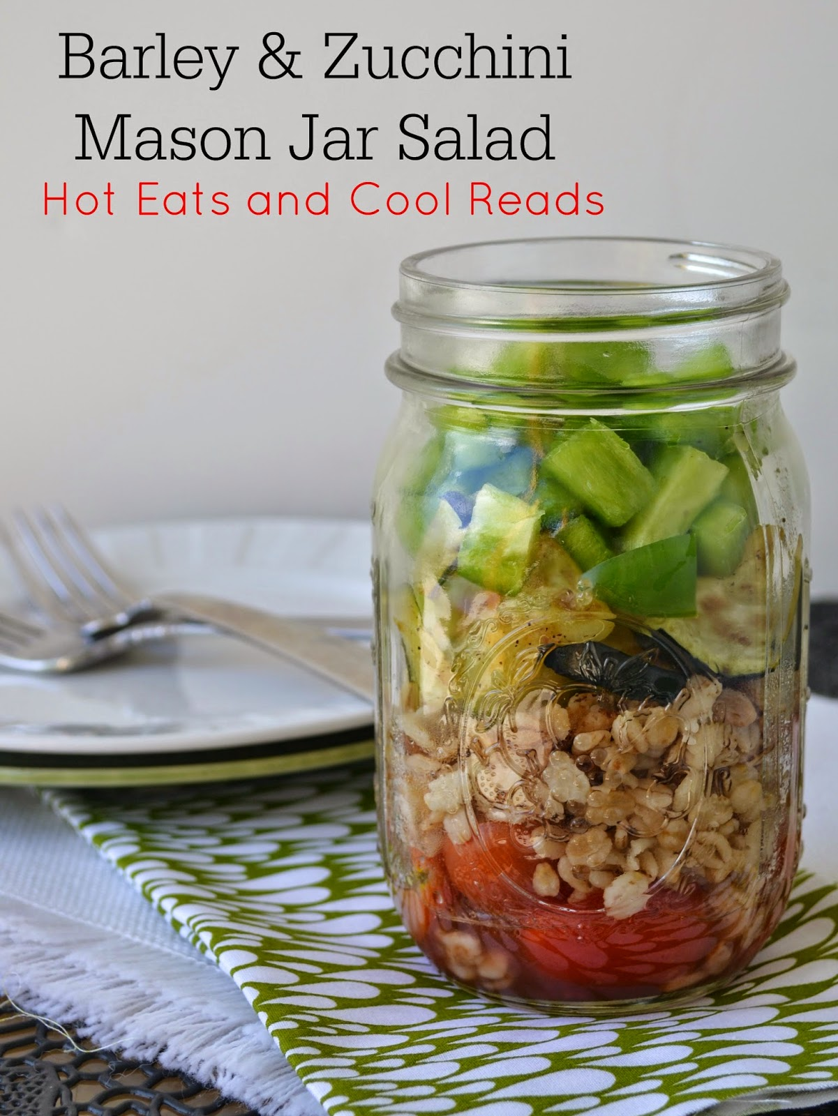 Need a new lunch idea? This jar salad is not only delicious, but healthy too! Packed full of veggies including bell pepper, zucchini and tomatoes! Barley and Zucchini Mason Jar Salad Recipe from Hot Eats and Cool Reads