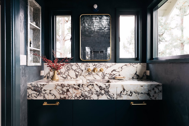 Calacatta Viola marble slabs for shower and vanity.