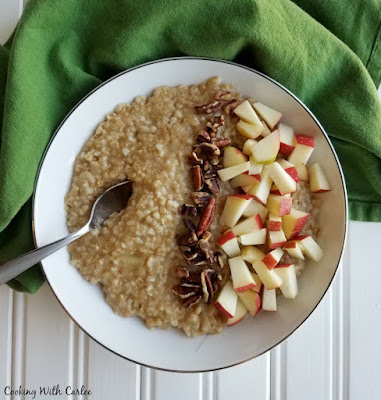 bowl of apple pie steel cut oats with diced apples and pecans