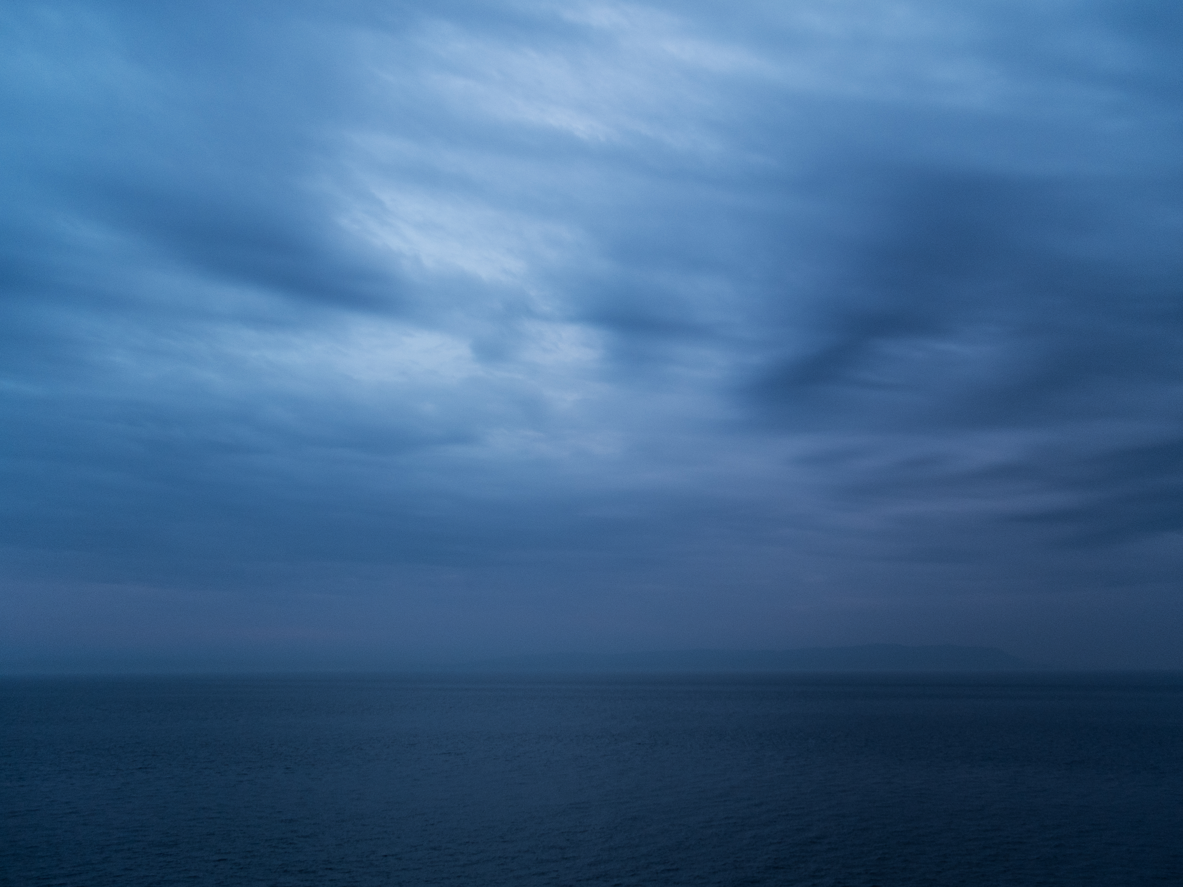 Blue skies and blue waters in the Strait of Gibraltar at twilight.