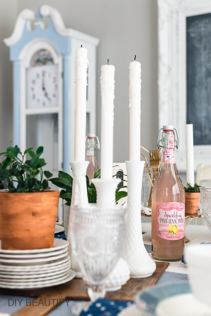 milk glass vases used as candleholders
