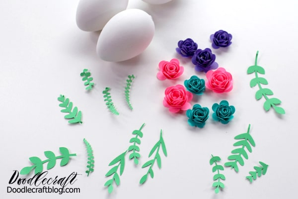 rolled paper flowers ready to hot glue to easter eggs
