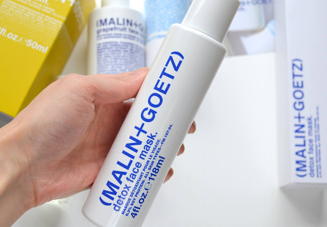 close up of malin and goetz face mask bottle