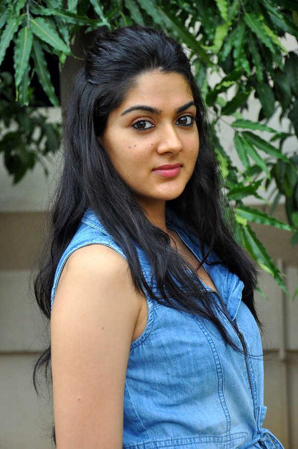 Sakshi Chaudhary Long Hair Stills In Blue Shirt Jeans