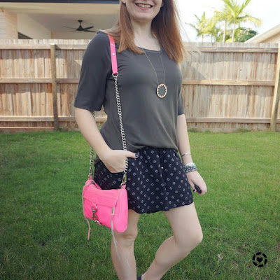 awayfromblue Instagram | olive and black printed shorts summer outfit with neon pink rebecca minkoff mini MAC bag