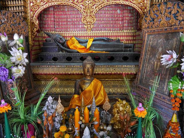 Lao bronze reclining Buddha statue in Luang Prabang, Laos