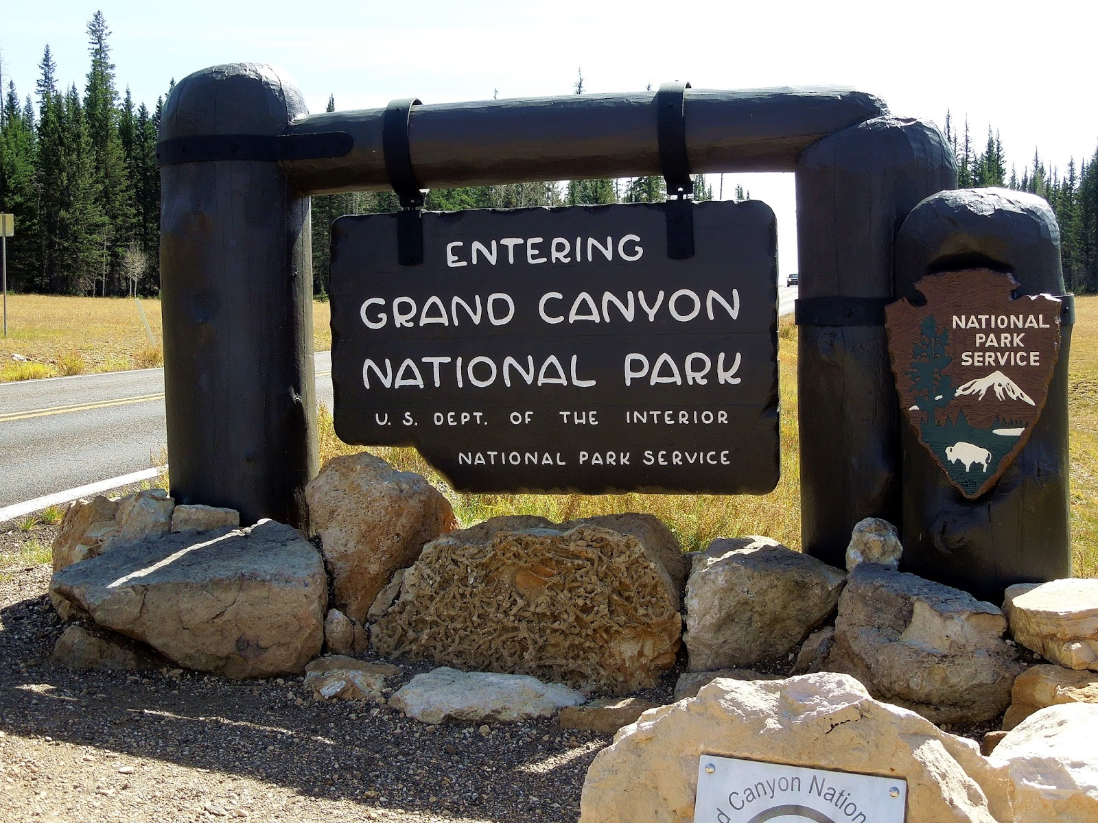 on a whim we took a side trip to the north rim of the grand canyon the first thing we do is stop at the park entrance sign for a photo nps park map