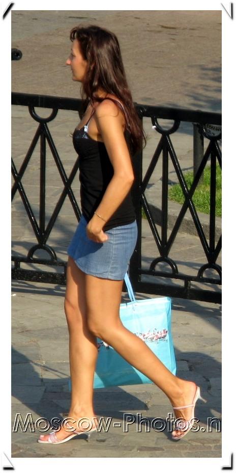Girl in black tank and denim miniskirt