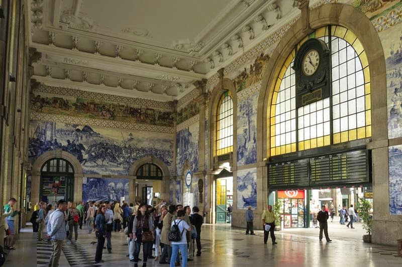 "São Bento Railway Station is located in the city of Porto, in Portugal. Inaugurated in 1916, the historical station is known for its tile ""azulejo"" panels that depict scenes of the History of Portugal. It is located in the Almeida Garret Square, in the centre of the city."