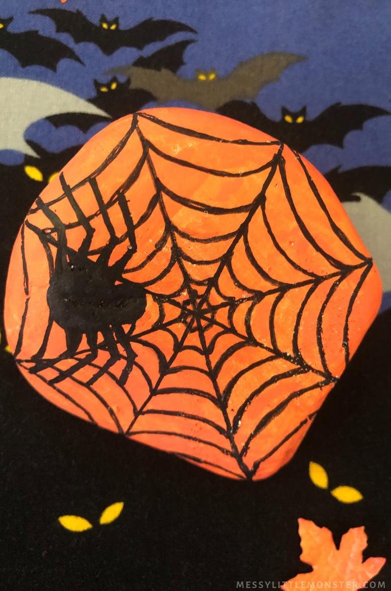 Halloween rock painting - spider web