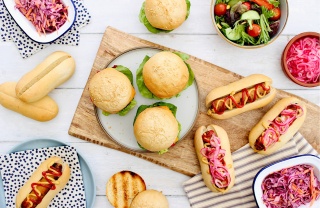 Burgers and hot dogs in buns