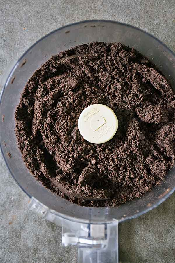 Crushed oreos in food processor for Raspberry White Chocolate Cheesecake recipe