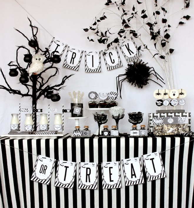 Tablescapes and mantels use feather boas buntings and swag to drape spray paint anything you can get your hands on in silver glitter black or white